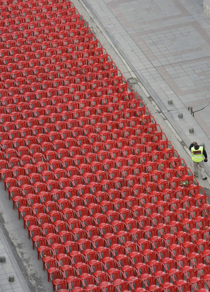Red chairs displayed along main street in Sarajevo to mark the 20th anniversary of the start of the Bosnian War on Friday, April, 6, 2012. City officials have lined up 11,541 red chairs arranged in 825 rows along the main street that now looks like a red river. Nobody will be sitting in them since the concert being held is for 11,541 Sarajevans who were killed during the siege.(AP Photo/Amel Emric)