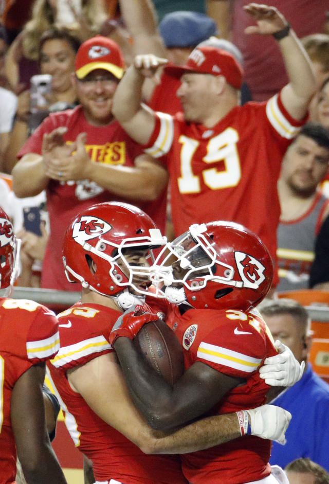 Kansas City Chiefs running back Darrel Williams, right, celebrates his touchdown with tight end Jace Amaro (89) during the first half of an NFL preseason football game against the Green Bay Packers in Kansas City, Mo., Thursday, Aug. 30, 2018. (AP Photo/Charlie Riedel)