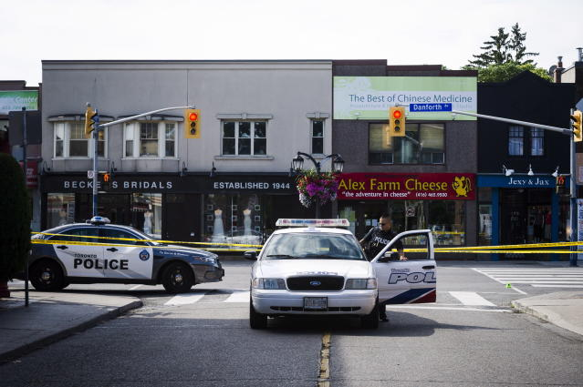 <p>Police are shown at the perimeter of the scene of a shooting in east Toronto, on July 23, 2018. Police were trying Monday to determine what prompted a 29-year-old man to go on a shooting rampage in a popular Toronto neighborhood. (Photo: Christopher Katsarov/The Canadian Press via AP) </p>