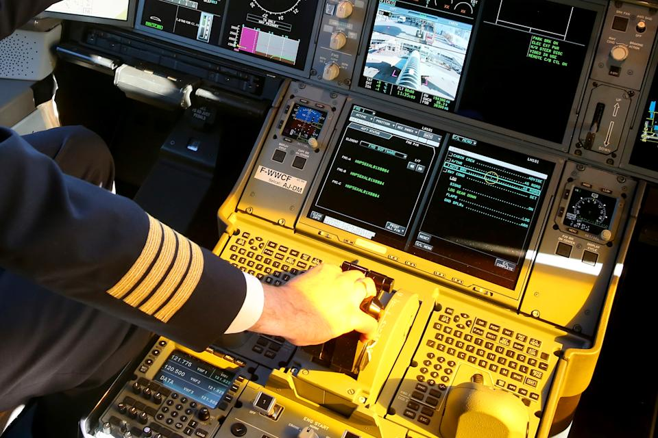 MUNICH, GERMANY - FEBRUARY 27:  A pilote on the flight deck in the new Airbus A350X WB passenger plane as he stands on the tarmac at Munich Airport during a presentation of the new plane by Airbus officials on February 27, 2015 in Munich, Germany. The A350 is a long-distance passenger plane that Airbus has developed to compete against the Boeing 787 Dreamliner.  (Photo by Alexander Hassenstein/Getty Images)