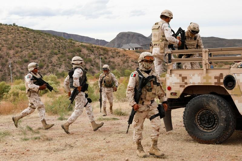 Soldiers are seen outside the Mormon community La Mora