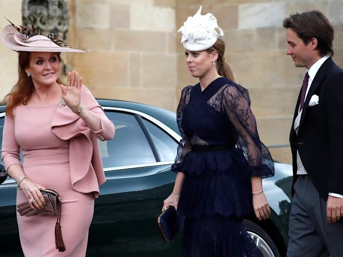 Britain's Sarah, Duchess of York, waves as she arrives with Princess Beatrice and Edoardo Mapelli Mozzi ahead of the wedding of Lady Gabriella Windsor and Thomas Kingston at St George's Chapel in Windsor Castle, in Windsor Castle, near London, Britain May 18, 2019.