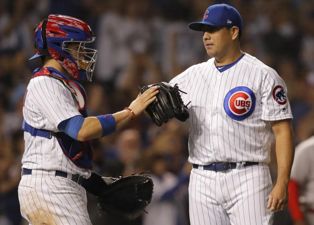 Chicago Cubs' Jorge De La Rosa, right, and Victor Caratini celebrate their win over the Cincinnati Reds at the end of a baseball game Friday, Sept. 14, 2018, in Chicago. (AP Photo/Jim Young)