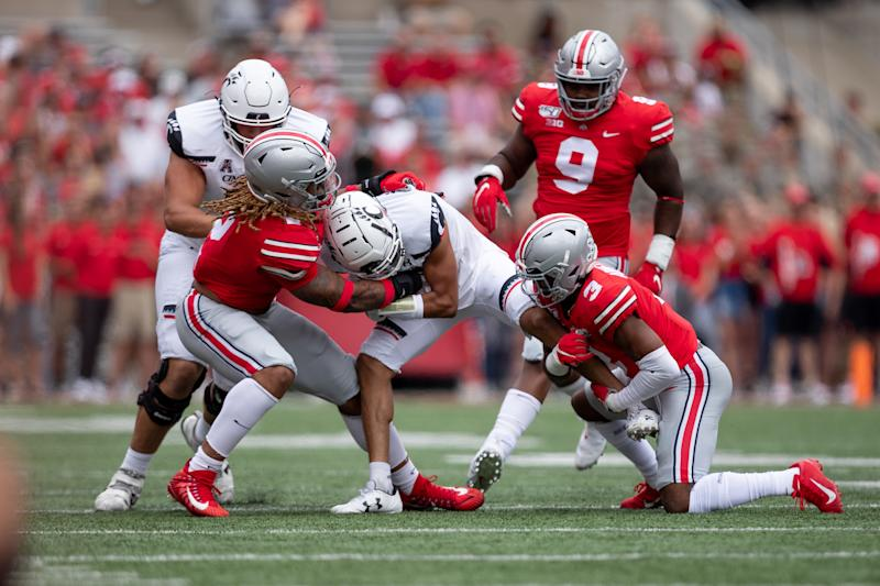 Ohio State DE Chase Young, left, has dominated through two games. (Getty Images)