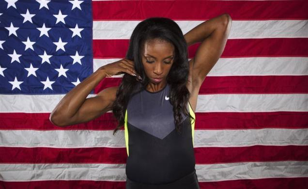 Hurdler Lashinda Demus poses for a portrait during the 2012 U.S. Olympic Team Media Summit in Dallas, May 13, 2012.
