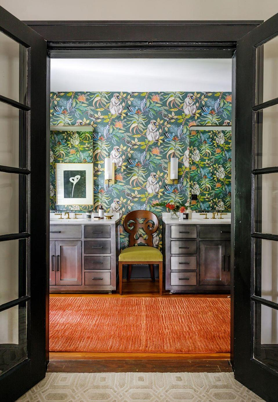 """<p>Every room in designer Fitz Pullins's Florida home is bursting with fun, including this bathroom with cheeky monkey-print wallpaper. """"What's more invigorating than a jungle?"""" Pullins says. """"Waking up, brushing your teeth—I want it to be entertaining for me.""""</p>"""