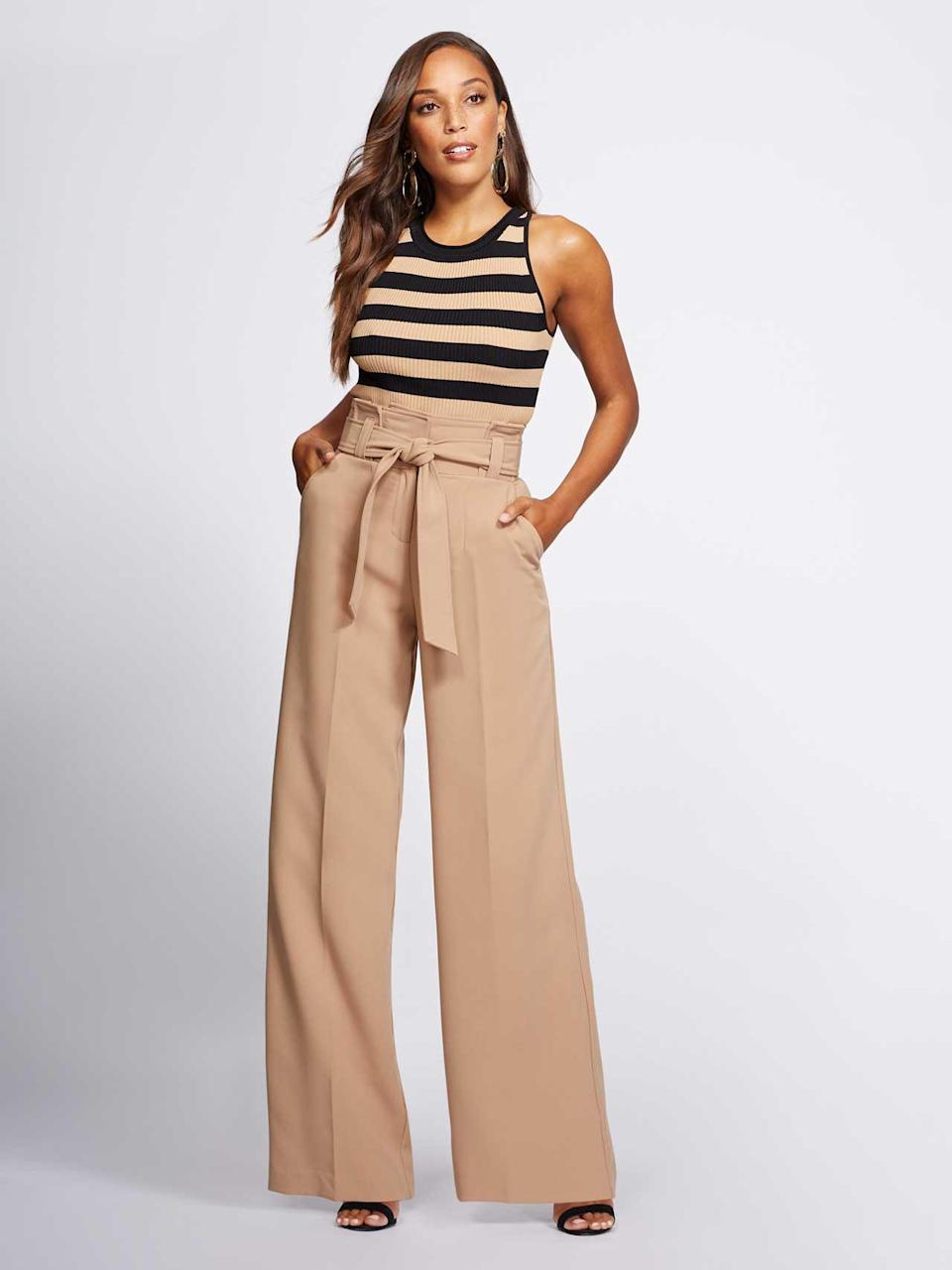 A striped tank top and wide-leg trousers make a casual yet put-together look. (Photo: Courtesy of New York & Company)