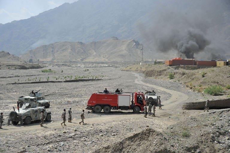 Smoke rises from close to a US military base in Torkham near the Pakistan border on September 2, 2013