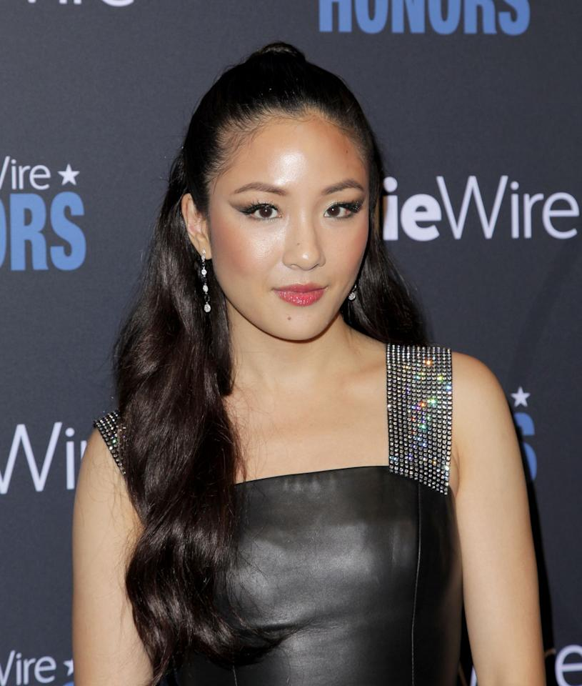 <p>Constance Wu opted for a flirty half up style, which included a high, slicked back ponytail. At the top, you can see her stylist wrapped a piece of her hair around the pony to up the glam factor. </p>