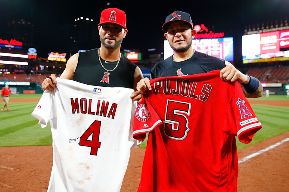Albert Pujols and Yadier Molina exchange jerseys after a game between the Cardinals and Angels.