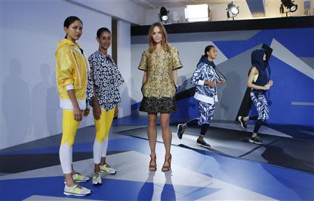 fff0653794 Designer McCartney poses with models wearing creations from the Adidas by Stella  McCartney Spring Summer