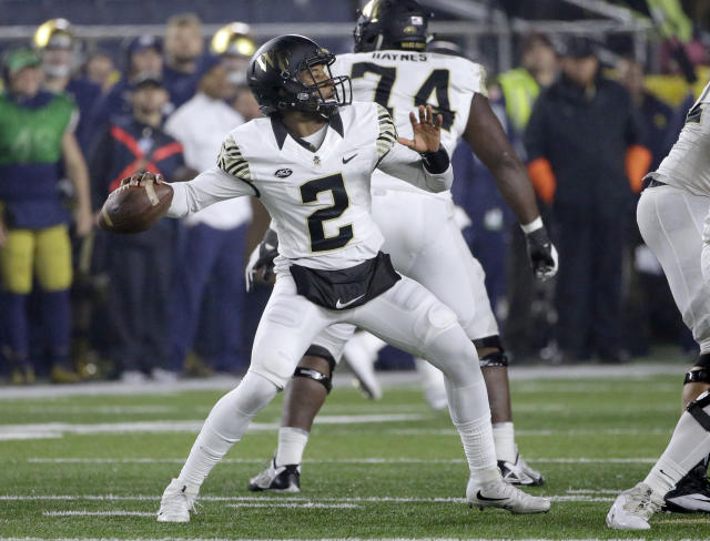 Wake Forest quarterback Kendall Hinton looks to pass against Notre Dame during the second half of an NCAA college football game Saturday, Nov. 4, 2017, in South Bend, Ind. Notre Dame won 48-37. (AP Photo/Nam Y. Huh)