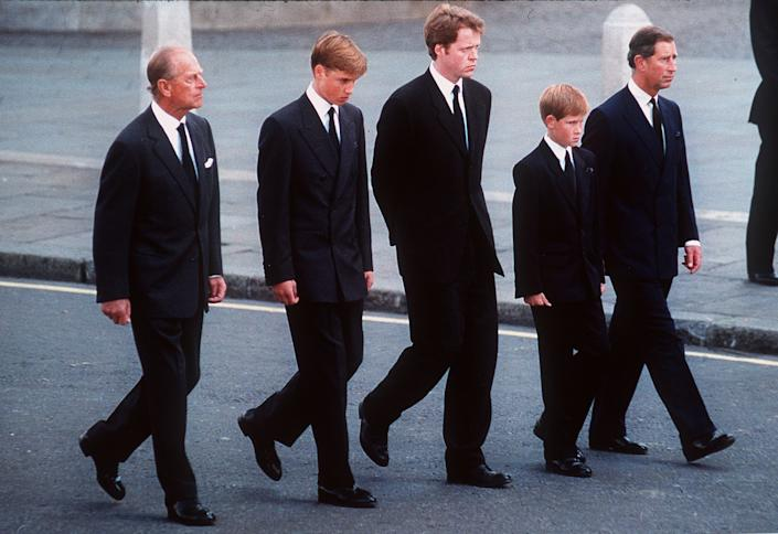 The Duke of Edinburgh, Prince William, Earl Spencer, Prince Harry and the Prince of Wales follow the coffin of Diana, Princess of Wales in September 1997. (Photo by Anwar Hussein/WireImage)