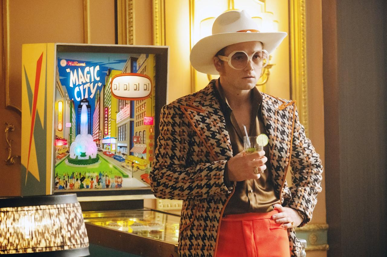 <ul> <li> <strong>What to wear:</strong> TBH, the crazier the outfit, the better. If you really want to dress up like the legend himself, you'll need circle sunglasses, a chic cowboy hat, and an outfit complete with colors and designs of all kinds. If you're really feeling wild, you can copy his devil outfit and go all out with feathers, flames, and sparkle, so much sparkle. </li> </ul>