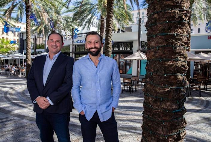 Jose Ortega and Marc Schwarzberg, partners at Maven Real Estate, bought the old Scientology building, turning a single-use structure into the heart of a new restaurant row on Giralda Plaza in Coral Gables.