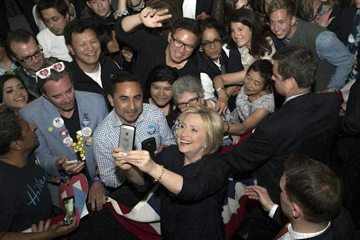 Democratic presidential candidate Hillary Clinton takes a selfie with fans after speaking at a rally in San Francisco, California on May 26, 2016 (AFP Photo/Josh Edelson)