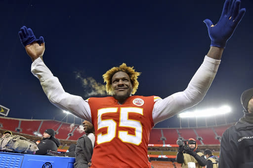 Kansas City Chiefs' Frank Clark celebrates after the NFL AFC Championship football game against the Tennessee Titans Sunday, Jan. 19, 2020, in Kansas City, MO. The Chiefs won 35-24 to advance to Super Bowl 54. (AP Photo/Ed Zurga)