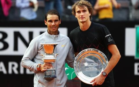 "As everyone had expected at the start of the week, Rafael Nadal left his traditional bite-mark on the Rome Masters trophy on Sunday. But no-one predicted that he would need a perfectly timed rain-shower to help him win the final, and move back to the top of the world rankings in the process. This final against Alexander Zverev, the German 20-year-old who now stands at No 3 in the world, appeared to be heading for an upset early in the deciding set. After dominating the opening set so emphatically that it occupied only 32 minutes, Nadal then lost seven of the next nine games. Zverev was apparently heading for a fourth ATP Masters 1000 title. He had established a 1-6, 6-1, 3-1 advantage when the rain arrived. The players then came back on for a single game, which saw Nadal hold serve for 2-3, before a second shower arrived. After that, it was one-way traffic. Nadal reeled off the final four games to take the decider 6-3 and claim this title for the eighth time. ""If we analyse now, of course we can say that the rain delay helped me,"" admitted Nadal afterwards. ""But really, in my opinion, what helped me is that I came back with a clear idea in terms of tactical issues and in terms of decisions that I take."" Nadal thus extended his dominance over Zverev – who will be the second seed at the French Open in a week's time – to five wins from as many matches. As Zverev admitted afterwards, the exertions of the past fortnight – which also saw him lift the title in Madrid – caught up with him in the end. ""Next time, I have to find a way to come out better after the rain and play better tennis,"" he said. ""The fatigue I had because of the last few weeks – because of the break, it took me very long time to get activated again."" Back on top: Rafael Nadal of Spain celebrates with the trophy after victory in his Mens Final match against Alexander Zverev of Germany Credit: Getty This result means that Nadal once again leapfrogs the absent Roger Federer and moves back to the top of the rankings for the sixth time in his glorious career. Even so, he will need to claim the Coupe des Mousquetaires in Paris for an 11th time if he wants to hold on to the No 1 spot going into the grass-court season. That's how it's done: Elina Svitolina of Ukraine kisses the trophy in celebration after the Women's Singles Credit: Getty In the women's final in Rome, fourth seed Elina Svitolina ran out a 6-0, 6-4 winner over world No 1 Simona Halep. Again, fatigue from previous rounds played a part. Halep admitted that she started out feeling stiff after Saturday's 2hr 23min semi-final against Maria Sharapova. ""The match for me yesterday, every time I play against Sharapova, the ball is coming very flat and I bend a lot so my back gets a little bit sore,"" said Halep. ""Today, I was not fresh enough to start the match better.""ends"