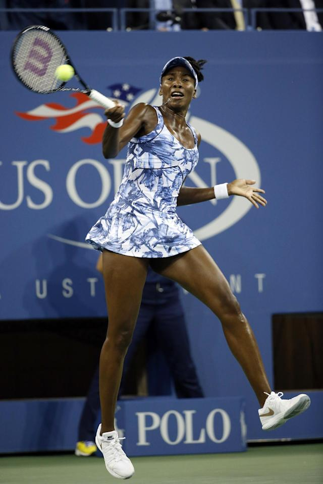 Venus Williams, of the United States, returns a shot to Timea Bacsinszky, of Switzerland, during the second round of the U.S. Open tennis tournament Wednesday, Aug. 27, 2014, in New York. (AP Photo/Jason DeCrow)