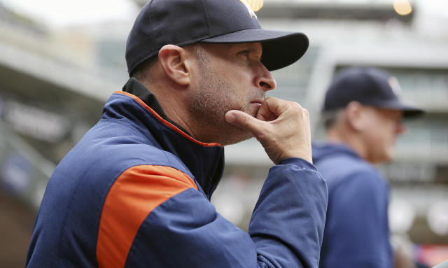 Houston Astros manager Al Hinch watches the baseball game against the Minnesota Twins Thursday, May 2, 2019, in Minneapolis. The Twins won 8-2, winning three games in the four-game series. (AP Photo/Jim Mone)