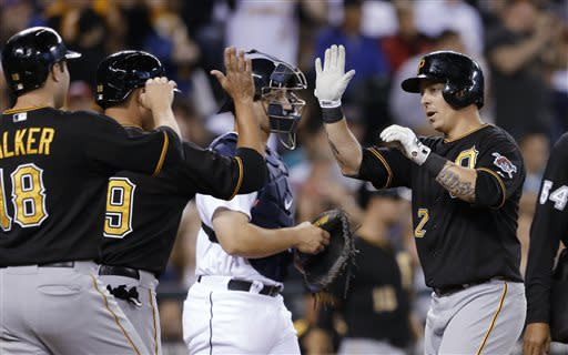 Pittsburgh Pirates' Brandon Inge (2) is greeted at home by Neil Walker (18) and Tony Sanchez after Inge's three-run home run, as Seattle Mariners catcher Mike Zunino waits for play to resume in the second inning of a baseball game Tuesday, June 25, 2013, in Seattle. (AP Photo/Elaine Thompson)
