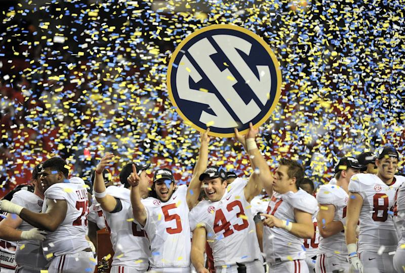 Alabama players celebrates after their 32-28 win in the Southeastern Conference championship NCAA college footballgame against Georgia, Saturday, Dec. 1, 2012, in Atlanta. (AP Photo/Atlanta Journal-Constitution, Hyosub Shin) MARIETTA DAILY OUT; GWINNETT DAILY POST OUT; LOCAL TV OUT; WXIA-TV OUT; WGCL-TV OUT
