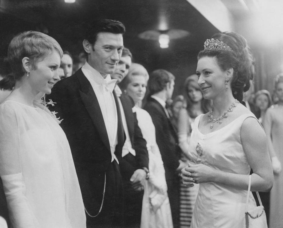 <p>Farrow wears a white chiffon evening gown to meet Princess Margaret in 1967. The Princess greeted Farrow and her costar, Laurence Harvey, at the London premiere of their film <em>The Taming of the Shrew. </em></p>