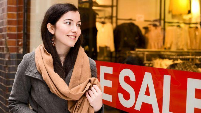 woman looking at sale while shopping