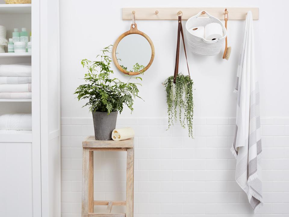 <p>No hook system is simpler than a Shaker peg rail, which uses a slim wooden backing board and sturdy cylindrical pegs to create a versatile spot to hang just about anything: Favorite photos with wire hangers, backpacks and tote bags, clothes and towels, or even plants and framed mirrors.</p>