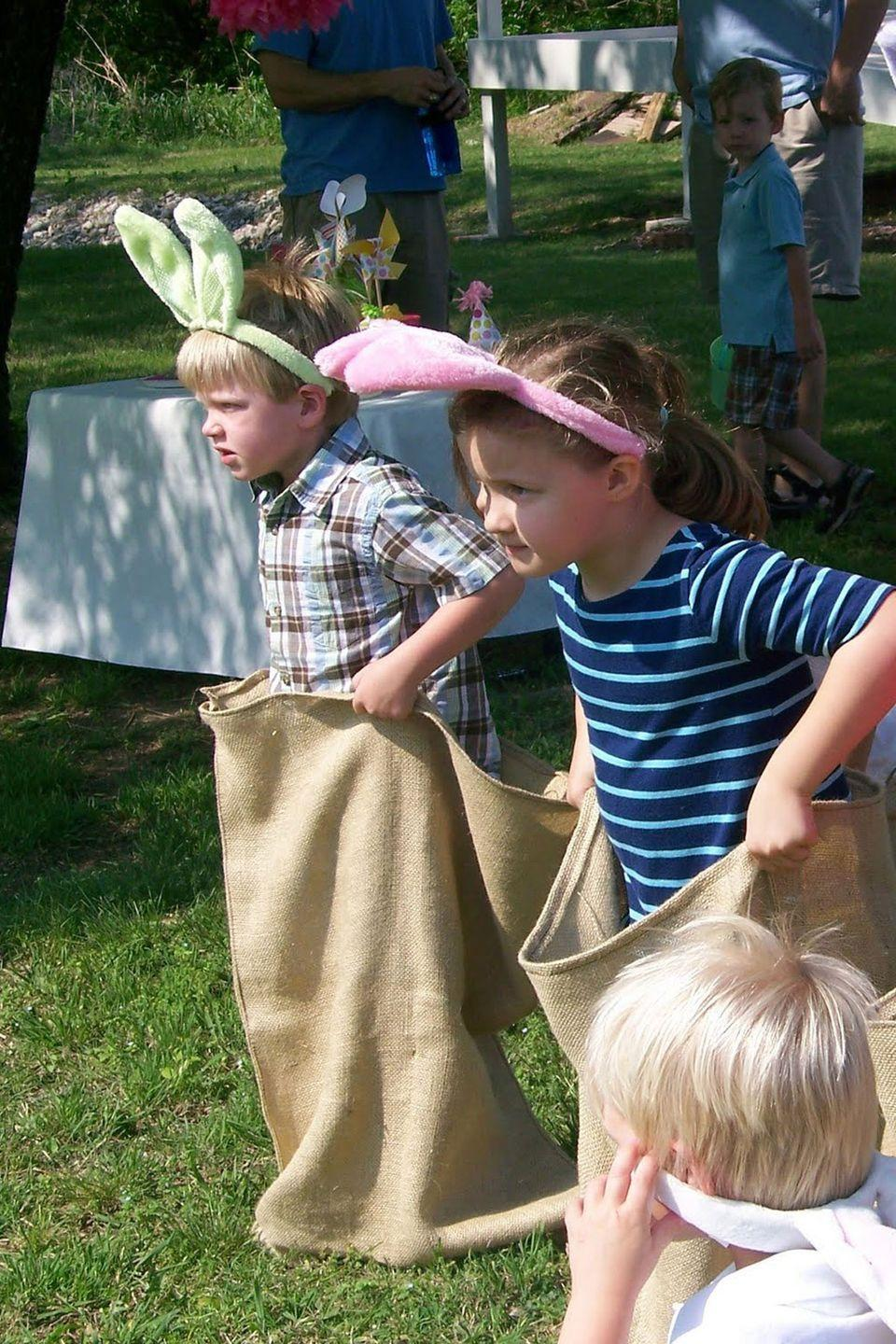 "<p>Upgrade your standard potato sack race for Easter with this fun party idea.</p><p><strong>Get the tutorial at <a href=""http://porch.com/gigglesgalore/easter-egg-hunt-party/"" rel=""nofollow noopener"" target=""_blank"" data-ylk=""slk:Giggles Galore"" class=""link rapid-noclick-resp"">Giggles Galore</a>.</strong> </p>"