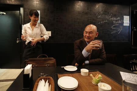 "Customer drinks distilled spirit at the Otasuke ""izakaya"" style pub and restaurant in Tokyo"