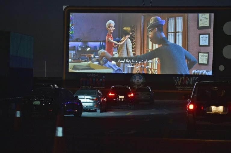 """Motorists take their place in a drive-in cinema in the Saudi capital Riyadh to watch """"Soul,"""" which has proved a worldwide hit"""