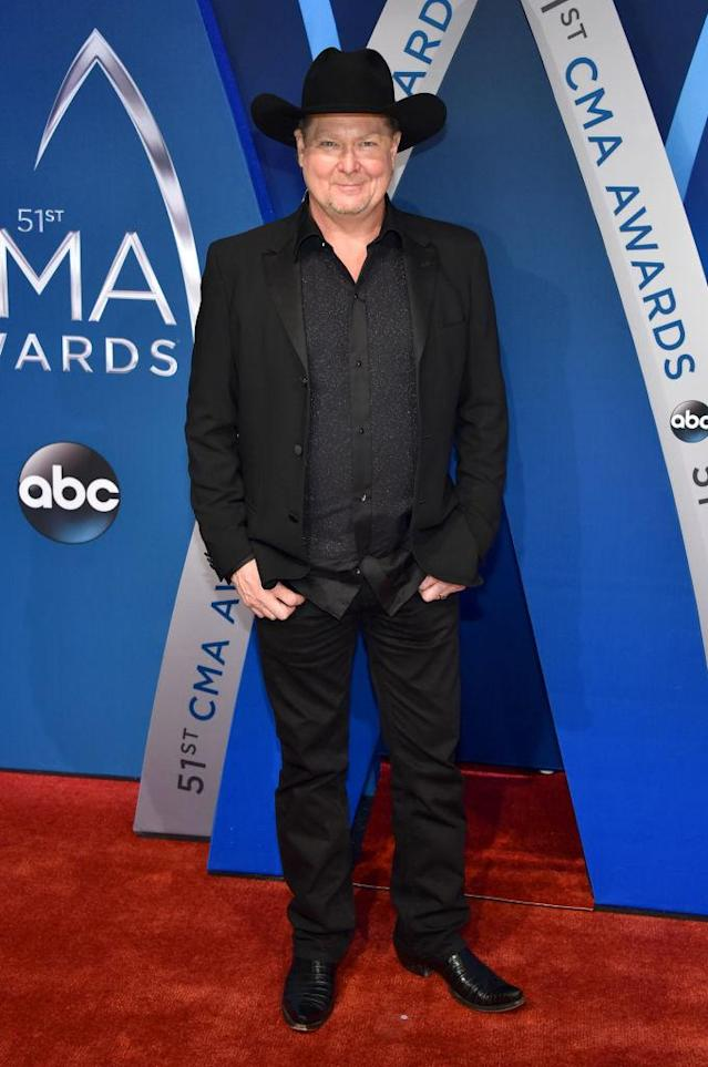 <p>Lawrence wears saltwater crocodile boots, with a custom cowboy hat and an Armani blazer. (Photo: Getty Images) </p>