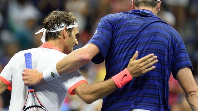 Isner and Federer in 2015. Image: Getty