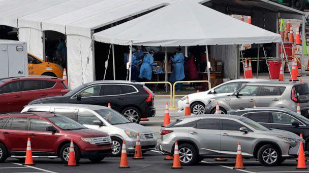 PHOTO: Lines of cars wait at a drive-through coronavirus testing site, July 5, 2020, outside in Miami Gardens, Fla.  (Wilfredo Lee/AP)