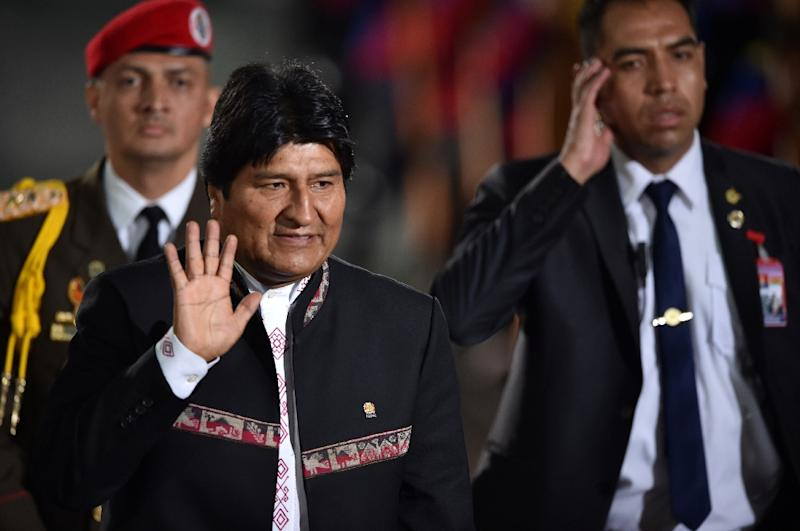Bolivia's President Evo Morales waves as he arrives for President Nicolas Maduro's inauguration (AFP Photo/YURI CORTEZ                         )