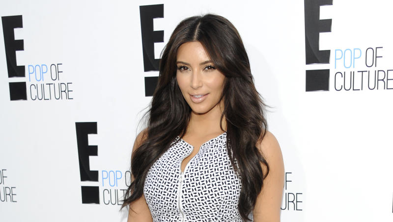 """FILE - In this April 30, 2012 file photo, Kim Kardashian from the show """"Keeping Up With The Kardashians"""" attends an E! Network upfront event at Gotham Hall in New York. Kardashian's lawsuit against Old Navy over an advertisement was dismissed Tuesday Aug. 28, 2012 after the two sides reached a settlement. Kardashian sued the retailer last year, claiming they violated her publicity rights by using a lookalike in an ad. (AP Photo/Evan Agostini, File)"""