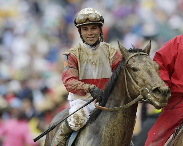 Joel Rosario reacts after riding Orb to victory in the 139th Kentucky Derby at Churchill Downs Saturday, May 4, 2013, in Louisville, Ky. (AP Photo/Darron Cummings)