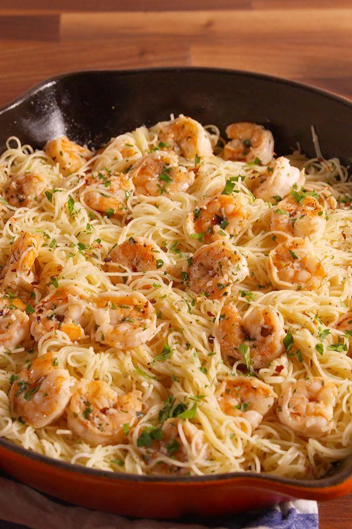 """<p>This pasta is truly heaven sent. Buttery, garlicky <a href=""""https://www.delish.com/uk/cooking/recipes/a31952820/prawn-salad/"""" rel=""""nofollow noopener"""" target=""""_blank"""" data-ylk=""""slk:prawns"""" class=""""link rapid-noclick-resp"""">prawns</a> tossed in a creamy Parmesan white wine sauce, then folded into a bed of angel hair pasta and topped with fresh herbs—and it's all ready in just under 30 minutes. Cooking at home has truly never felt so easy and tasted so good.</p><p>Get the <a href=""""https://www.delish.com/uk/cooking/recipes/a32204917/best-garlic-butter-shrimp-pasta-recipe/"""" rel=""""nofollow noopener"""" target=""""_blank"""" data-ylk=""""slk:Garlic Butter Prawn Pasta"""" class=""""link rapid-noclick-resp"""">Garlic Butter Prawn Pasta</a> recipe. </p>"""