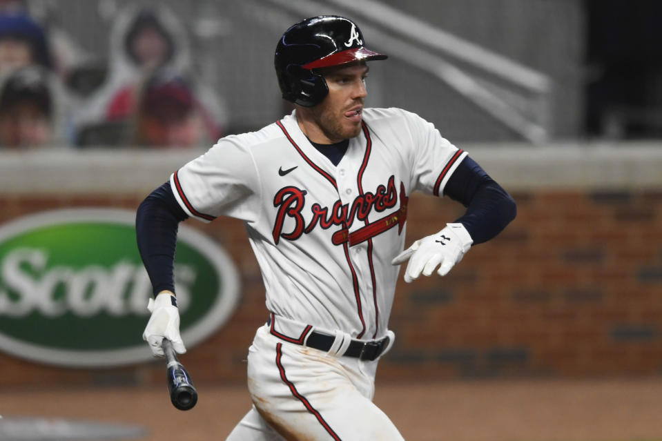 Atlanta Braves' Freddie Freeman hits a line drive RBI single to centerfield during the sixth inning of a baseball game against the Tampa Bay Rays, Wednesday, July 29, 2020 in Atlanta. The Braves won 7-4. (AP Photo/John Amis)