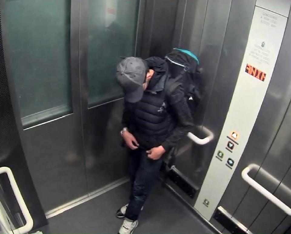 Salman Abedi adjusting wiring underneath his clothing as he carries his suicide bomb in a lift at Manchester Arena shortly before the attack on 22 May 2017Manchester Arena Inquiry