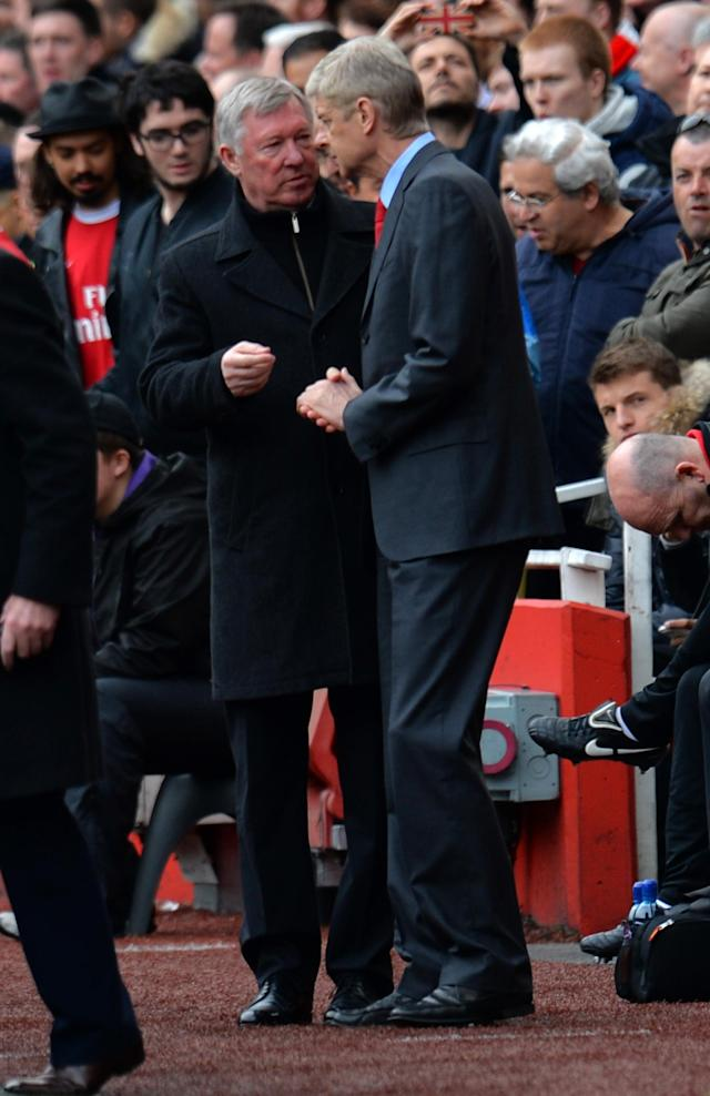 LONDON, ENGLAND - APRIL 28: Sir Alex Ferguson of Manchester United talks to Manager Arsene Wenger of Arsenal ahead of the Barclays Premier League match between Arsenal and Manchester United at Emirates Stadium on April 28, 2013 in London, England. (Photo by Shaun Botterill/Getty Images)