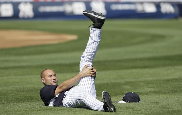 New York Yankees shortstop Derek Jeter stretches during spring training baseball practice Thursday, Feb. 20, 2014, in Tampa, Fla. (AP Photo/Charlie Neibergall)