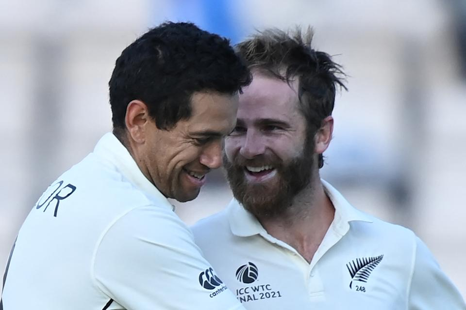 New Zealand's Ross Taylor (L) and New Zealand's captain Kane Williamson celebrate victory on the final day of the ICC World Test Championship Final between New Zealand and India at the Ageas Bowl in Southampton, southwest England on June 23, 2021. - New Zealand beat India by 8 wickets. - RESTRICTED TO EDITORIAL USE (Photo by Glyn KIRK / AFP) / RESTRICTED TO EDITORIAL USE (Photo by GLYN KIRK/AFP via Getty Images)