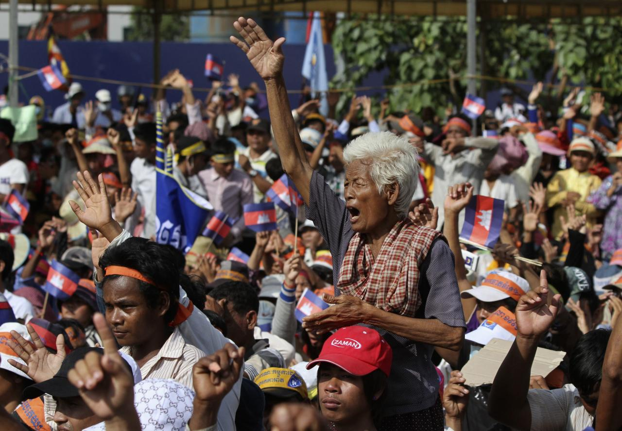 Supporters of the opposition Cambodia National Rescue Party (CNRP) protest at the Freedom Park in central Phnom Penh October 23, 2013. The CNRP began a three-day mass demonstration on Wednesday over a disputed national election, which extended the long serving Prime Minister Hun Sen's rule for another five years. Thousands of CNRP supporters gathered at the park and marched to foreign embassies to push for an independent probe into the July 28 polls. REUTERS/Samrang Pring (CAMBODIA - Tags: POLITICS CIVIL UNREST ELECTIONS)