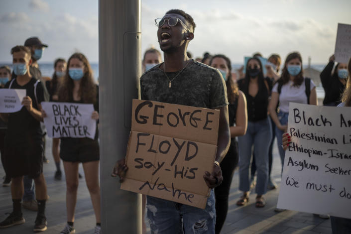 CLARIFIES THAT LOCATION IS THE U.S. EMBASSY BRANCH OFFICE TEL AVIV: Protesters shout slogans during a protest to decry the killing of George Floyd in front of the U.S. Embassy Branch Office, in Tel Aviv, Israel, Tuesday, June 2, 2020. (AP Photo/Ariel Schalit)
