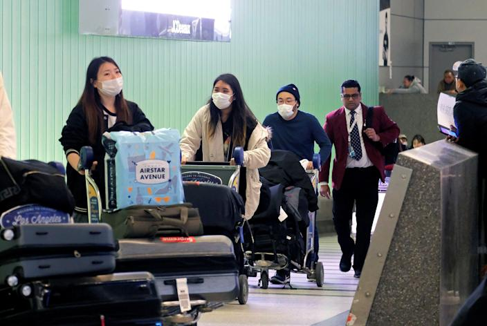 Passengers come to LAX from Shanghai, China, following the announcement of a positive case of coronavirus in the Orange County suburb of Los Angeles, California, US, 26 January, 2020. REUTERS / Ringo Chiu