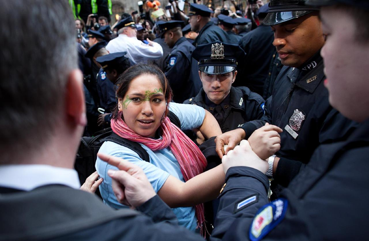 An Occupy Wall Street demonstrator is arrested in Zuccotti Park after a march to celebrate the protest's sixth month, Saturday, March 17, 2012, in New York. With the city's attention focused on the huge St. Patrick's Day Parade many blocks uptown, the Occupy rally at Zuccotti Park on Saturday drew a far smaller crowd than the demonstrations seen in the city when the movement was at its peak in the fall. A couple hundred people attended. (AP Photo/John Minchillo)