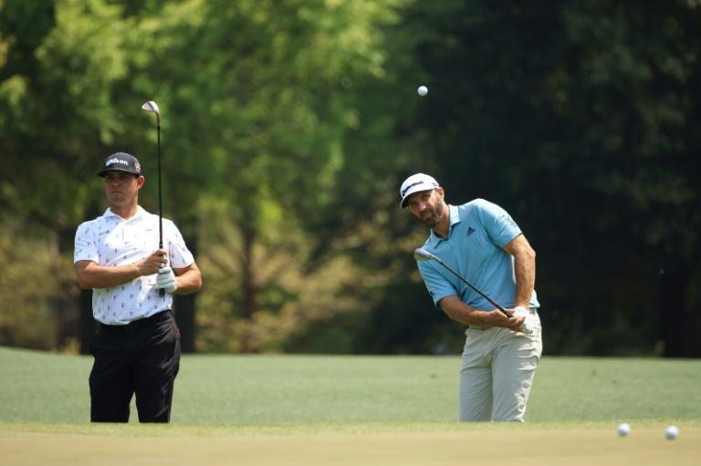 Top-ranked defending champion Dustin Johnson, right, and fellow American Gary Woodland test some shots during a final practice round Wednesday ahead of Thursday's start of the 85th Masters