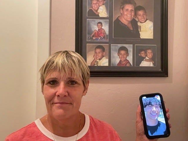 Kris Rodeman of San Carlos Park stands in front of childhood photos of her son and a photo on her cell phone of him now.  Her son was tased by an FHP officer not far from his home June 16 and remains in the Southwest Florida Juvenile Justice Center. His mom plans on proceeding with a lawsuit against the FHP trooper who tased her son.